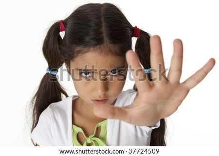 Little girl is makes a stop gesture with her hand