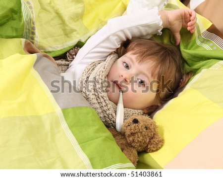 Little girl lying sick in bed