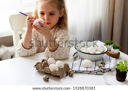 Little girl paints easter eggs. Easter concept.Preparing for Easter. Happy easter. Сток-фото ©