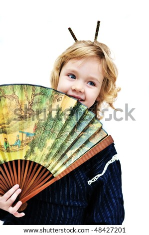 little girl with fan wearing like oriental girl.