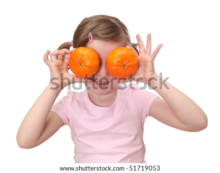 Little girl with oranges isolated on white background