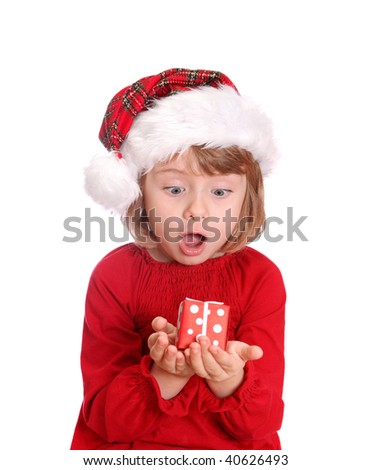 Little girl with santa hat and red gift box isolated on white background