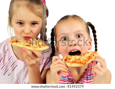 little girls eating pizza
