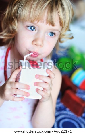 little lovely girl drinking juice from straw