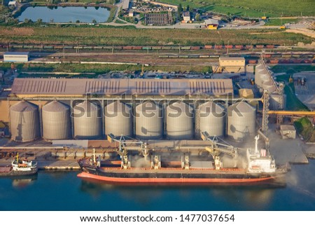loading a ship with grain in the seaport aerial conveyour grain industry loading port sea shiploader silo storehouse transport transhipment trade berth handling