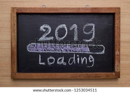 2019 loading with progress bar, chalk drawing on blackboard #1253034511