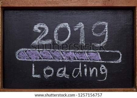 2019 loading with progress bar, chalk drawing on blackboard #1257156757