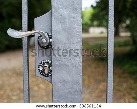 Lock and metal door handle in closed Park gates, Schwetzingen, Germany