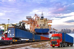 Logistics industrial ,Containers shipping and container box loading and transportation of Container truck and rail train with ship port background and twilight sky ,cargo /logistic business concept