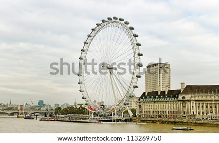 LONDON - OCTOBER 16: View of London Eye,which is the tallest ferris wheel in Europe, along the bank of the Thames River on October16, 2011 in London.