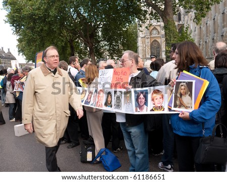 LONDON, UK-SEPTEMBER 17: Protesters About the Pope\'s Visit to the UK, Greet the Crowds Outside Westminster Abbey Sept 17, 2010 in London