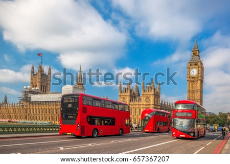 london with red buses against...
