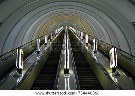 Long escalators at one of the deep metro stations - Kyiv (Kiev) Metro #734440366