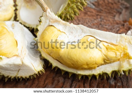 'Long Lub Lae' Durian flesh on old wooden background, 'Long Lub Lae' is the famous Durian of Uttaradit Province, Thailand Zdjęcia stock ©