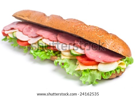 long whole wheat baguette sandwich with meat, vegetables and cheese