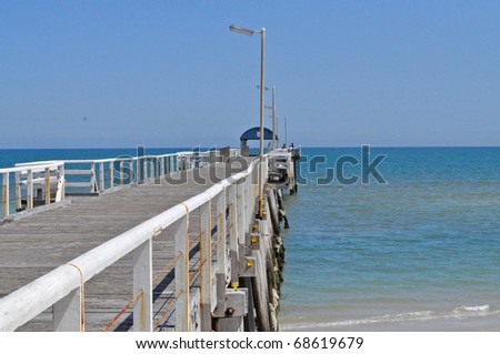 Long wooden jetty at the ocean. Australia