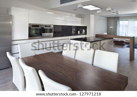 look into the brand new beautiful kitchen in a modern style and living room in one - stock photo