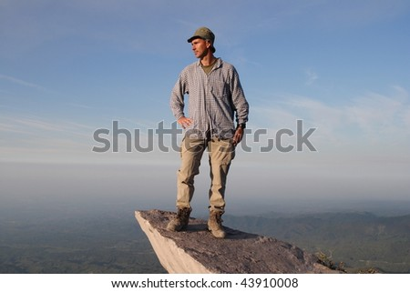 Looking far in the future.   The photographer with self portrait on a rock in the Guatemala Highland. Volcano Santa Maria  view to the pacific coast