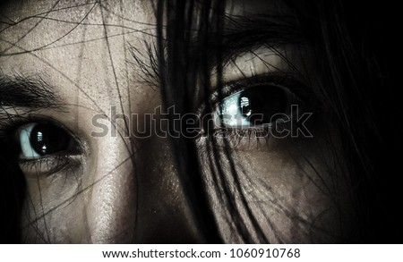 Looking in the darkness - dark brown eyes-  grief and fear - look depression - sad girl whith black hair- eyes in anguish