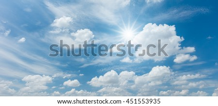 Looking up view of panorama blue sky with clouds and sun reflection #451553935