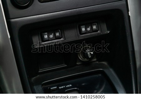 Сlose-up of the car  black interior:  dashboard, seat heating buttons, auto hold buttons and other.  #1410258005