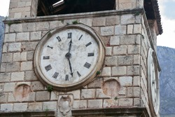 lose up of the Clock on the Tower on the Square of Arms. Kotor, Montenegro