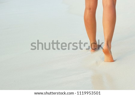 Сlose up of woman leg on the beach. Woman  feet walking on the sand. Foot female.Skin Care. #1119953501