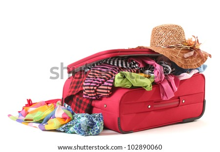 ?losed red suitcase with clothing isolated on white
