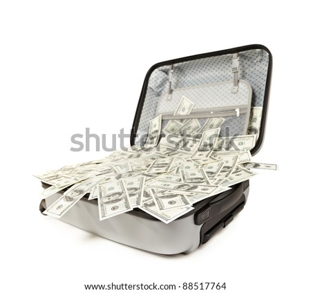 lot of money in a opened suitcase isolated on white