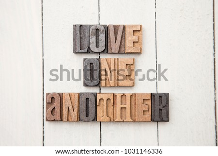 'Love One Another' Spelled in Type Set Stock foto ©