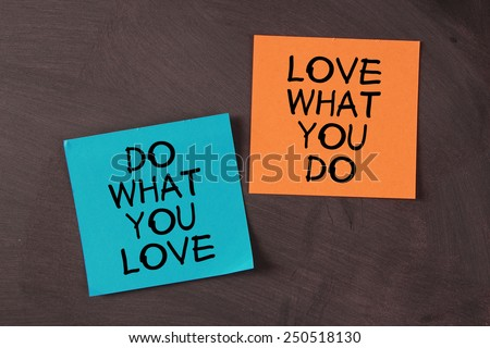 \'Love What You Do and Do What You Love\' notes pasted on blackboard.
