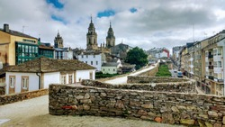 Lugo city, Galicia, Spain. Roman walls of Lugo town, listed as World Heritage by UNESCO and Cathedral