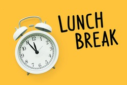 Lunch break time,Time for Lunch, Alarm clock on yellow background
