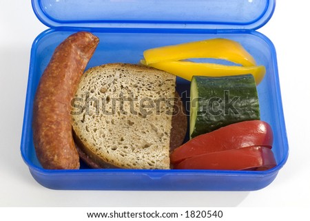 lunchbox with foodstuff  isolated on white background