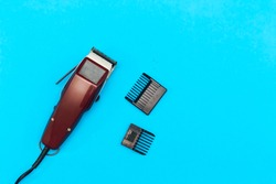 machine for a hairstyle. Barbershop. Hair clippers isolated on blue background. The machine for a hairstyle. Hair clippers isolated on  blue background