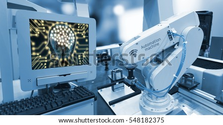 Machine learning and artificial intelligence concept. Computer display illustrative screen and blue tone of automate wireless Robot arm in smart factory background #548182375