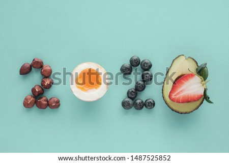 2020 made from healthy food on pastel blue background, Healthy happy New year resolution diet goals and lifestyle