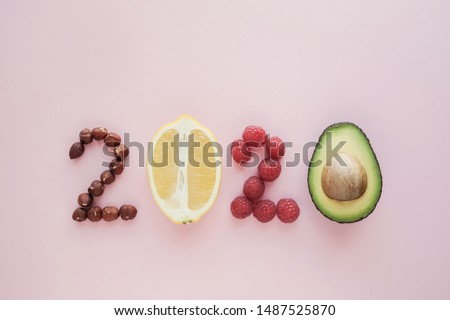 2020 made from healthy food on pink background, Happy New year, health diet resolution, goals and lifestyle