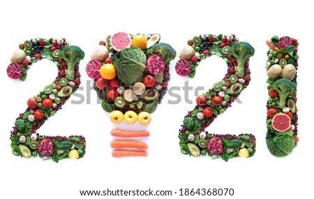 2021 made of fruits and vegetables including a light bulb icon