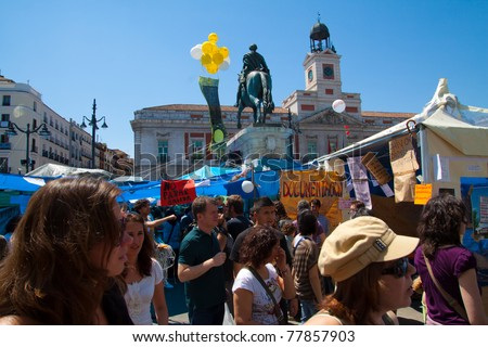 MADRID - MAY 15: Demonstrators gather to protest for economic equality during the Spanish Revolution days in Puerta del Sol Square in Madrid, Spain on May 15, 2011.
