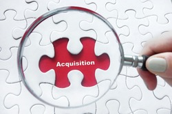 Magnifying glass over jigsaw puzzle: Acquisition