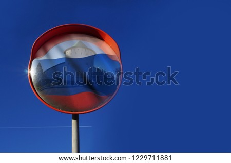 magnifying road mirror - as a symbol of friendship, politics, the situation in Russia. Flag of Russia   #1229711881