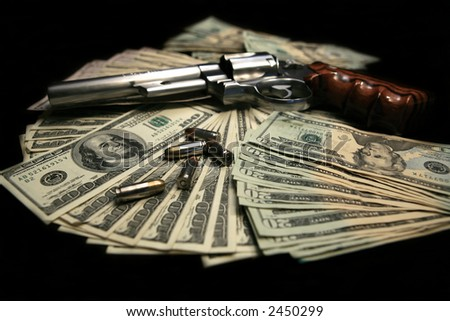 357 magnum handgun on a pile of money with bullets