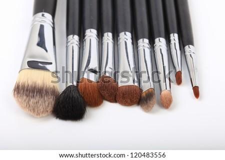 makemake-up brushes isolated on a white background - beauty treatment
