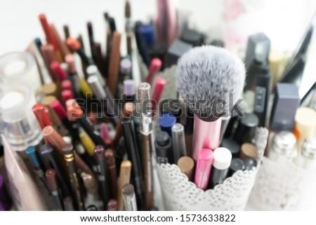 makeup pencils and makeup brush