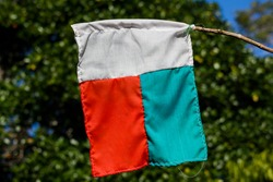 Malagasy flag hanging on the side