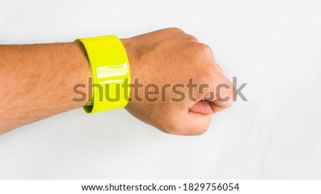 Photo of   male hand wrap promotion reflective yellow slap