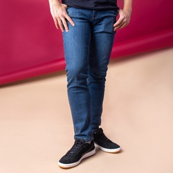 male legs in jeans on background