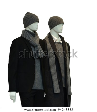 2 male mannequins with winter clothes isolated on white