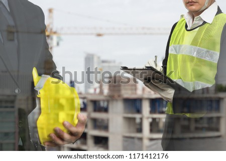 2 male occupational health and safety officer inside construction site doing inspection